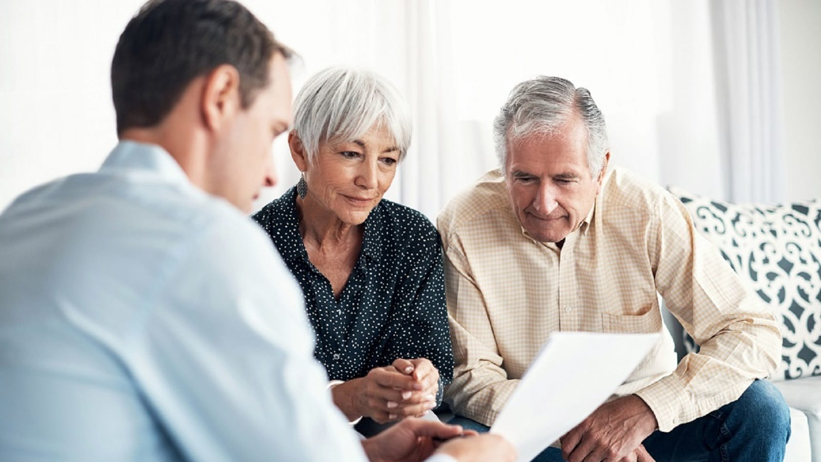 Elderly Couple With Lawyer Stock Photo
