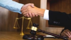 Judge Shaking Hands With An Attorney Stock Photo