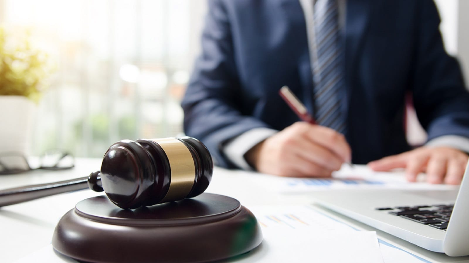 Male Lawyer Signing Legal Document Stock Photo
