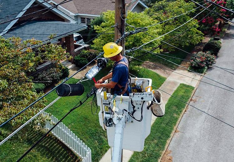 Utility worker working on powerlines