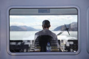 Ship Captain Looking Out Boat Window