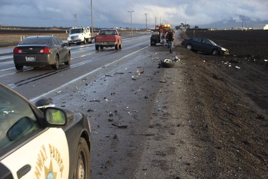 Emergency vehicle responding to highway car accident