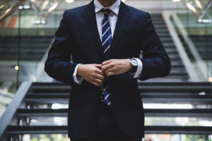 Business professional buttoning suit