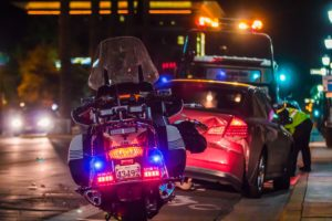 Police motorbike behind auto accident