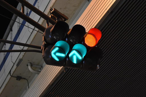 Stop lights that are signalling green and red for different directions