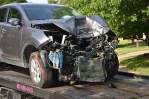 totaled gray vehicle after front end collision