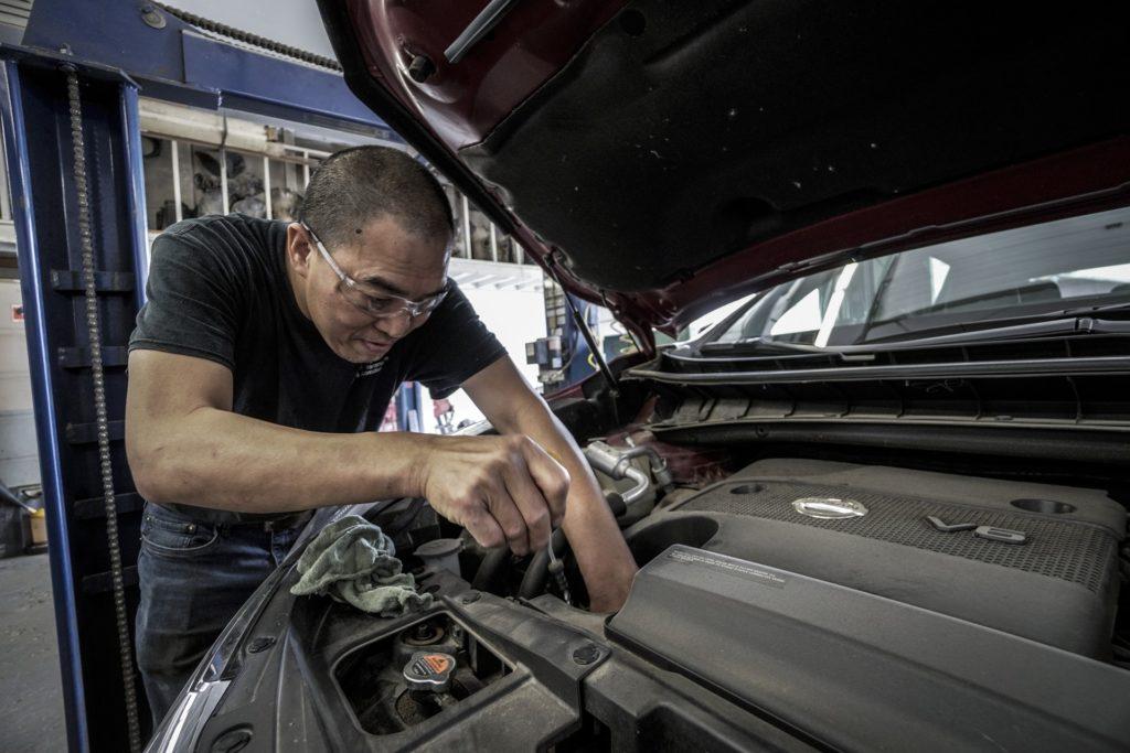 Car mechanic working on engine - Source: Pixabay: Ryan Doka